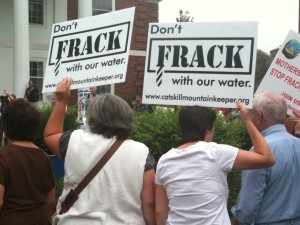 Protestors with don't frack signs